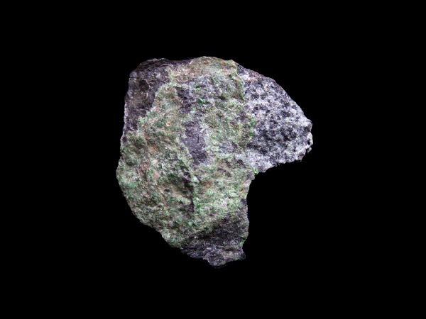 A green crystal from the garnet group of minerals.